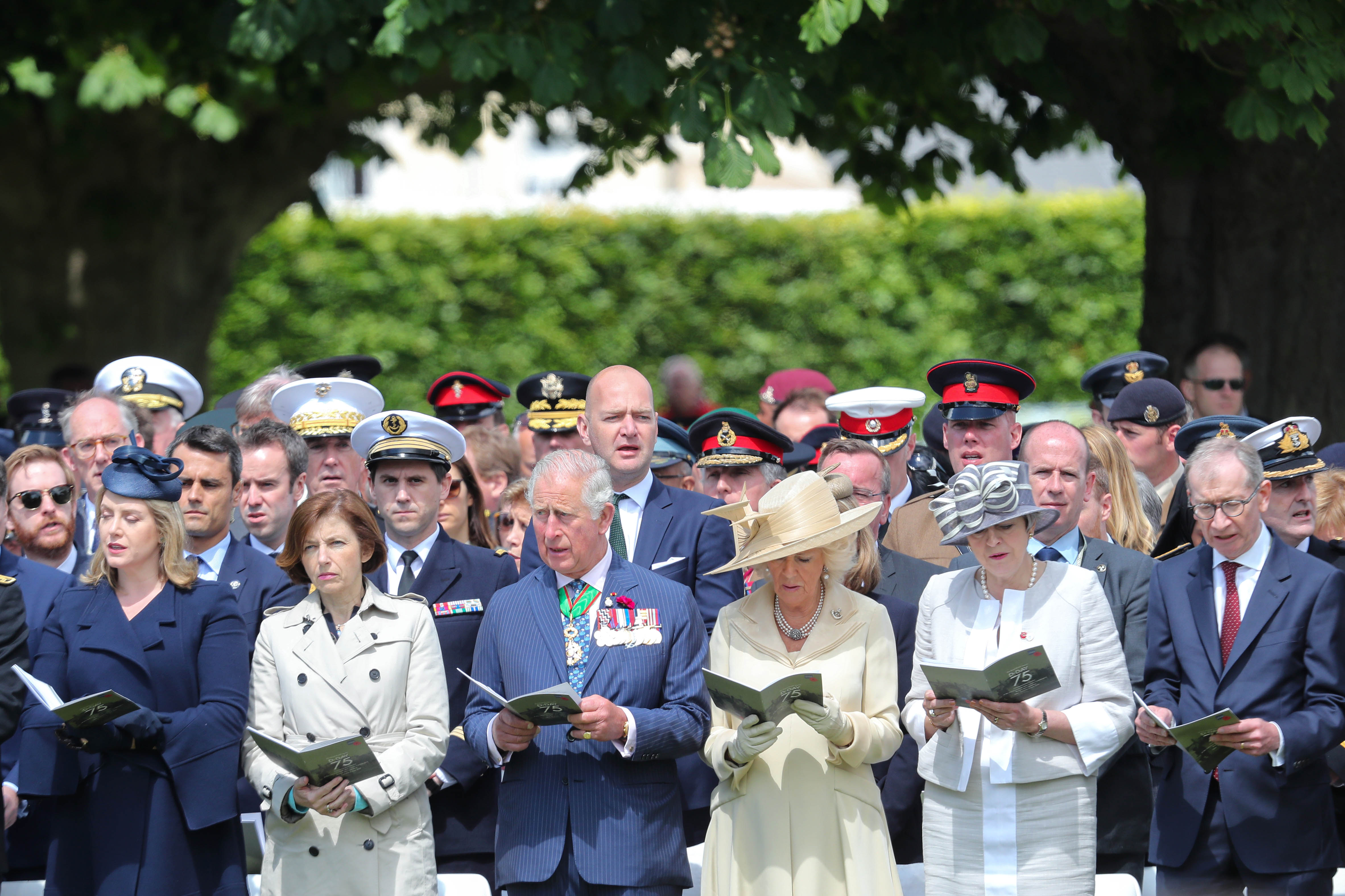 BAYEUX, FRANCE - JUNE 06: Secretary of State for Defence, Penny Mourdaunt, Prince Charles, Prince of Wales, Camilla, Duchess of Cornwall and Britain's Prime Minister Theresa May attend a memorial service at Bayeux War Cemetery on June 06, 2019 in Bayeux, France. Veterans, families, visitors, political leaders and military personnel are gathering in Normandy to commemorate D-Day, which heralded the Allied advance towards Germany and victory about 11 months later. (Photo by Chris Jackson/Getty Images)