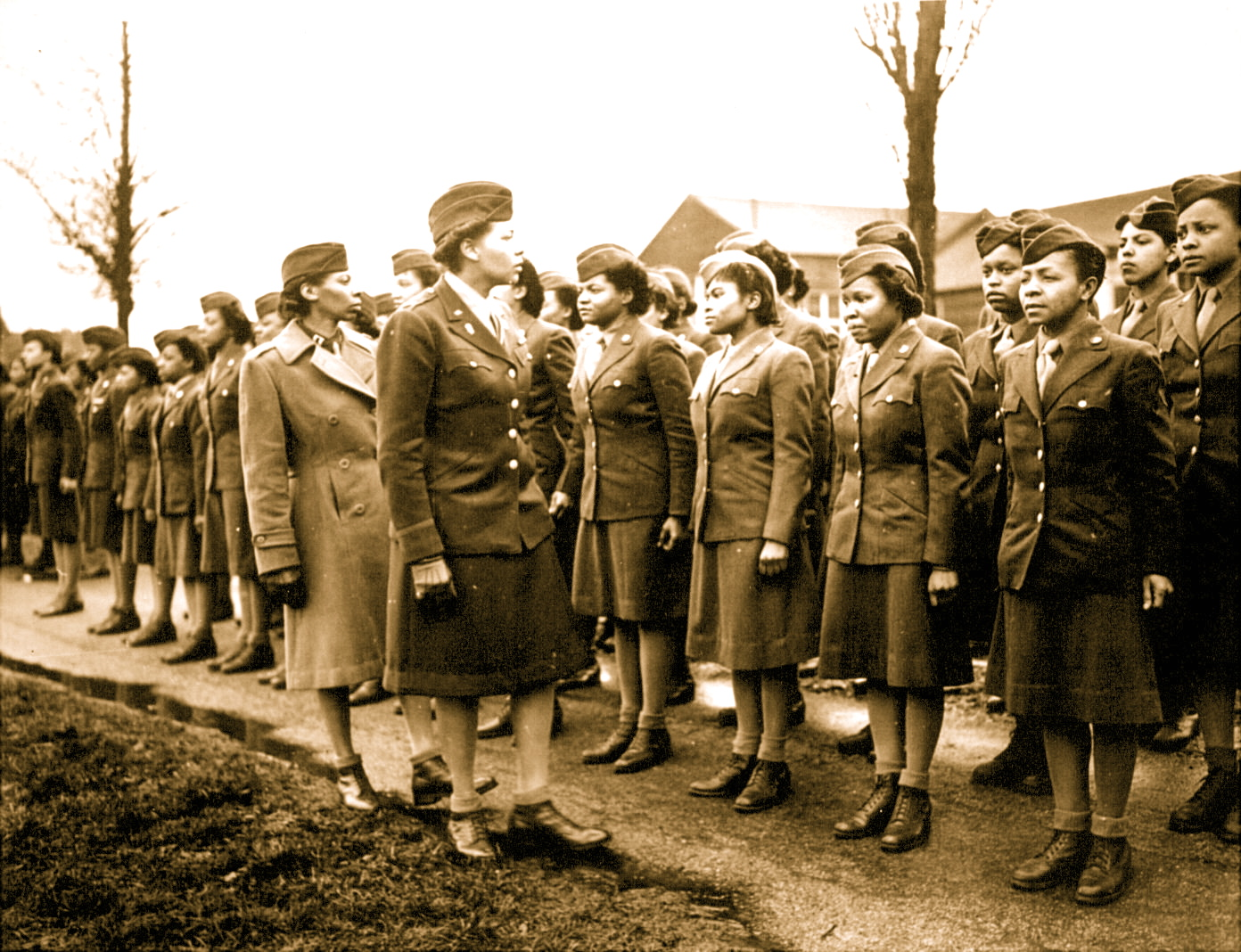 12-Major Charity E. Adams and Capt. Abbiy Cambell inspect the Members of the 6888th unit.pdf