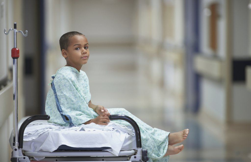 Mixed Race boy in hospital gown