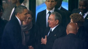Image: U.S. President Obama shaking hands with Cuban President Castro during Nelson Mandela's national memorial service in Johannesburg