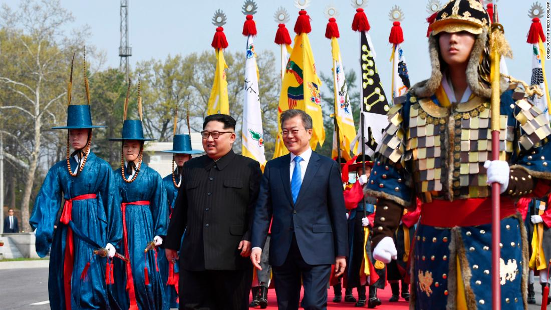 North Korean leader Kim Jong Un, left, and South Korean President Moon Jae-in walk together at the border village of Panmunjom in the Demilitarized Zone Friday, April 27, 2018. Kim made history Friday by crossing over the world's most heavily armed border to greet his rival, Moon, for talks on North Korea's nuclear weapons. (Korea Summit Press Pool via AP)