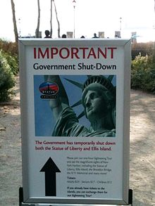220px-US_federal_government_shutdown_notice_near_the_Statue_of_Liberty