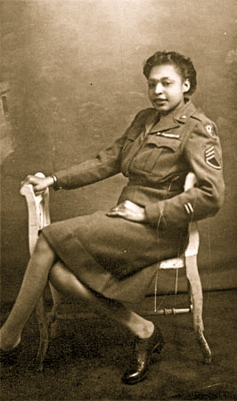 49-Millie Dunn Veasey poses in a chair in her WAC battle dress jacket and skirt in Birmingham, England, in 1945 copy