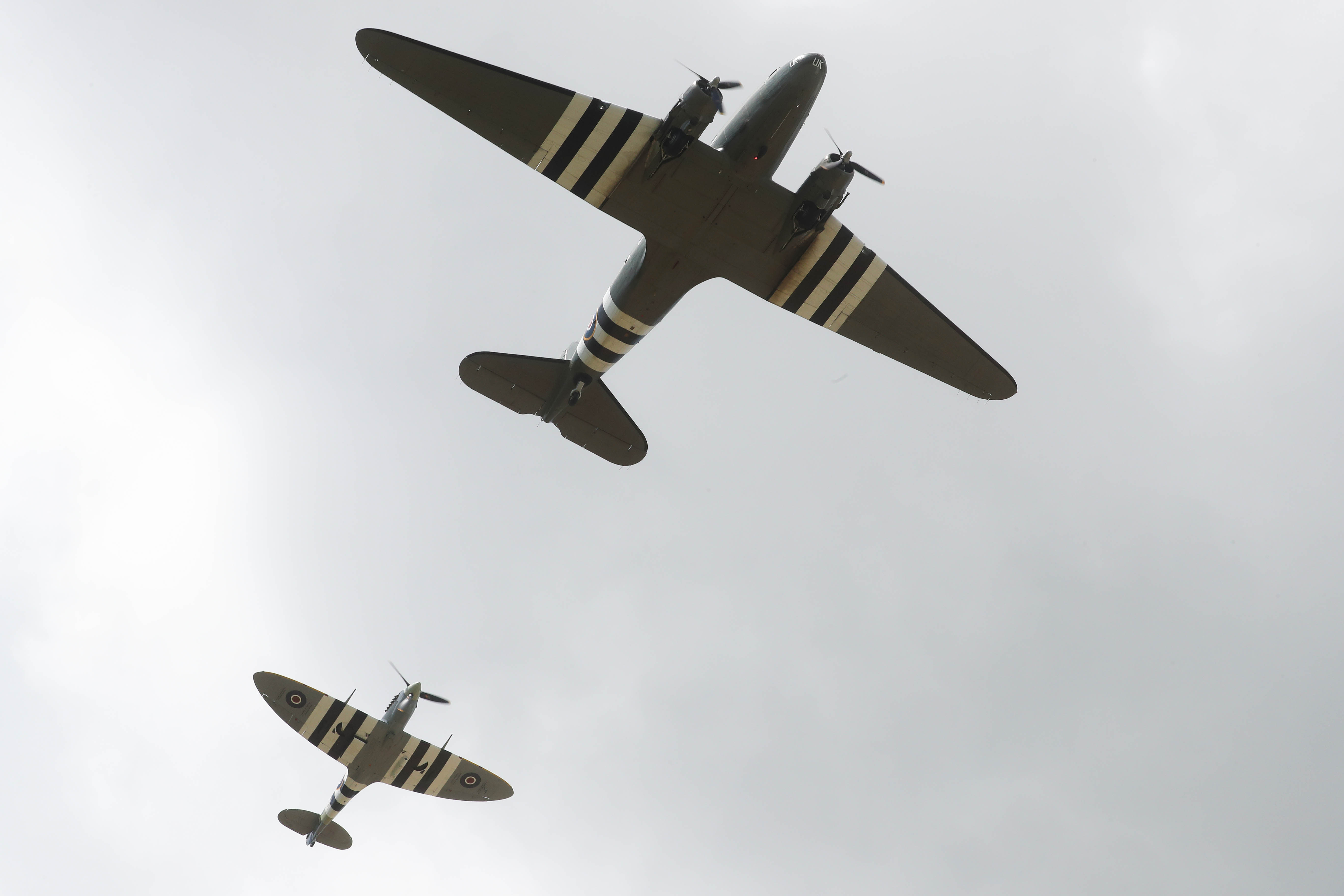 BAYEUX, FRANCE - JUNE 06: A flypast during a memorial service at Bayeux War Cemetery on June 06, 2019 in Bayeux, France. Veterans, families, visitors, political leaders and military personnel are gathering in Normandy to commemorate D-Day, which heralded the Allied advance towards Germany and victory about 11 months later. (Photo by Chris Jackson/Getty Images)