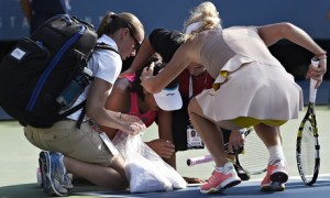 Caroline Wozniacki, right, checks on Shuai Peng during their US Open semi-final