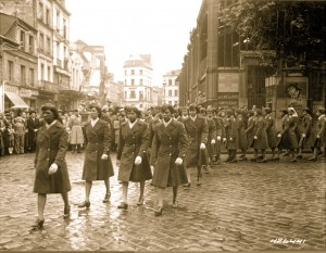 13-Members of the 6888th Central Postal Directory Battalion march in a parade cememony in honor of Joan d'Arc at the marketplace where she burned at the stake in, May 27, 1945 (c. National Archive)